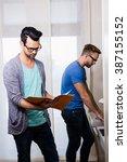 happy gay couple working... | Shutterstock . vector #387155152