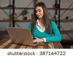 beautiful freelancer is working ... | Shutterstock . vector #387164722