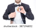 Man Holding A Golden Easter Egg
