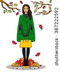 young  beautiful woman to coat... | Shutterstock .eps vector #387222592