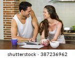 young couple looking at each... | Shutterstock . vector #387236962