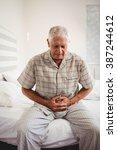 sick senior man suffering from...   Shutterstock . vector #387244612