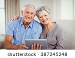 portrait of senior couple... | Shutterstock . vector #387245248