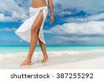 white pareo woman legs walking... | Shutterstock . vector #387255292