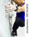 portrait of fit woman rock... | Shutterstock . vector #387262822
