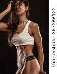 nice sexy fitness woman showing ... | Shutterstock . vector #387266122