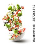 flying salad isolated on white... | Shutterstock . vector #387266542