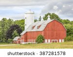 A Large Red Barn With A Tall...