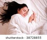 beautiful young woman sleeping | Shutterstock . vector #38728855