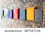 Multicolored Mailboxes Hanging...