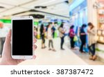 girl use mobile phone  blur...   Shutterstock . vector #387387472