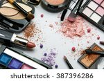 makeup products on white... | Shutterstock . vector #387396286