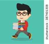 boy happy with books | Shutterstock .eps vector #387401308