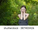 caucasian girl relaxing and... | Shutterstock . vector #387403426