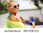 tan woman applying sun... | Shutterstock . vector #387428722