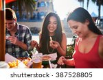 friends eating french fries and ... | Shutterstock . vector #387528805