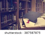 graduation cap and books step... | Shutterstock . vector #387587875