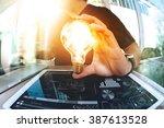 designer hand showing creative... | Shutterstock . vector #387613528