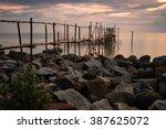 Bamboo Pier At Rocks Foregroun...