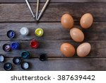 eggs and color on wood... | Shutterstock . vector #387639442