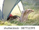 two young women with their legs ... | Shutterstock . vector #387711595