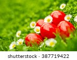 Red Easter Eggs In Green Grass...