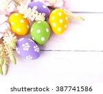 colorful easter eggs on white...   Shutterstock . vector #387741586