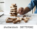 hand of engineer playing a... | Shutterstock . vector #387759382