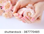 hands of a woman with pink... | Shutterstock . vector #387770485