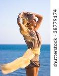 beautiful blonde girl with... | Shutterstock . vector #38779174