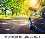 car on asphalt road in summer | Shutterstock . vector #387793576