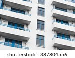Balconies On A White Apartment...