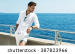 handsome man wearing white... | Shutterstock . vector #387823966