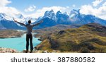 Small photo of man at mirador condor enjoying hiking and view of cuernos del paine in torres del paine national park, patagonia, chile