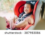 a baby sit in the car seat for... | Shutterstock . vector #387983086