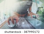 designer hand working with... | Shutterstock . vector #387990172
