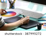 female hand drawing on the... | Shutterstock . vector #387995272