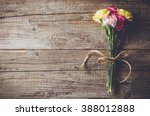 carnation flowers on wooden... | Shutterstock . vector #388012888