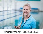pretty trainer holding a... | Shutterstock . vector #388033162