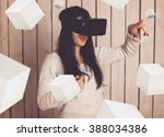 woman in virtual reality helmet.... | Shutterstock . vector #388034386