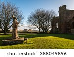 Small photo of St Aidan Statue / Statue of St Aidan the founder of the Lindisfarne Monastery overlooks the ruins today