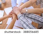 business people joining hands... | Shutterstock . vector #388056685