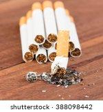 cigarettes  on the wooden floor. | Shutterstock . vector #388098442