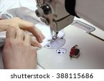 sewing process   women's hands... | Shutterstock . vector #388115686