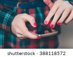 female hand click on the... | Shutterstock . vector #388118572