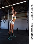 woman working out at a gym with ... | Shutterstock . vector #388153876