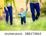 parents holding hands of their... | Shutterstock . vector #388173865