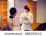 two women chatting in the cafe | Shutterstock . vector #388250212