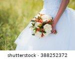 beautiful bouquet in hands of... | Shutterstock . vector #388252372