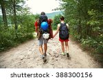young couple hikers in forest.... | Shutterstock . vector #388300156